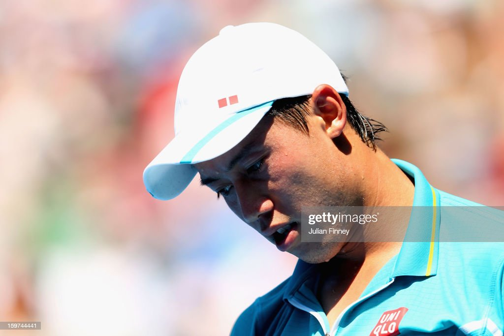 Kei Nishikori of Japan reacts after his fourth round match against David Ferrer of of Spain during day seven of the 2013 Australian Open at Melbourne Park on January 20, 2013 in Melbourne, Australia.