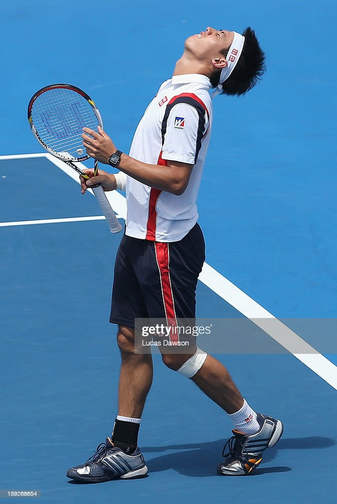 <a gi-track='captionPersonalityLinkClicked' href=/galleries/search?phrase=Kei+Nishikori&family=editorial&specificpeople=4432498 ng-click='$event.stopPropagation()'>Kei Nishikori</a> of Japan reacts after missing a ball during his match against Paul-Henri Mathieu of France during day three of the AAMI Classic at Kooyong on January 11, 2013 in Melbourne, Australia.