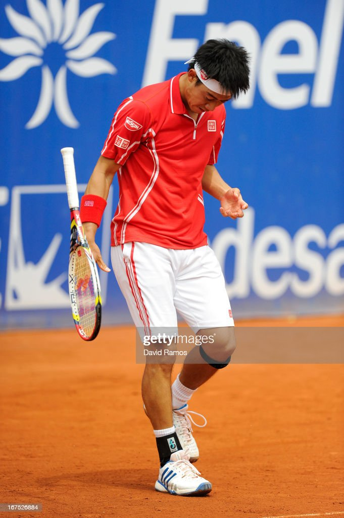 <a gi-track='captionPersonalityLinkClicked' href=/galleries/search?phrase=Kei+Nishikori&family=editorial&specificpeople=4432498 ng-click='$event.stopPropagation()'>Kei Nishikori</a> of Japan reacts after missing a point against Albert Ramos of Spain during day five of the 2013 Barcelona Open Banc Sabadell on April 26, 2013 in Barcelona, Spain. <a gi-track='captionPersonalityLinkClicked' href=/galleries/search?phrase=Kei+Nishikori&family=editorial&specificpeople=4432498 ng-click='$event.stopPropagation()'>Kei Nishikori</a> lost 4-6, 6-7.