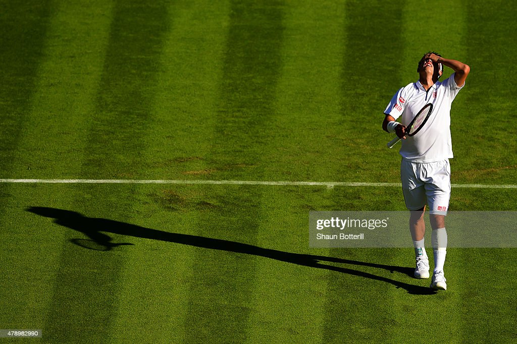 Kei Nishikori of Japan reacts after winning his Gentlemen's Singles first round match against Simone Bolelli of Italy during day one of the Wimbledon Lawn Tennis Championships at the All England Lawn Tennis and Croquet Club on June 29, 2015 in London, England.