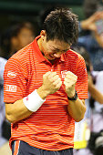 Kei Nishikori of Japan reacts after winning the men's singles final match against Milos Raonic of Canada on day seven of Rakuten Open 2014 at Ariake...