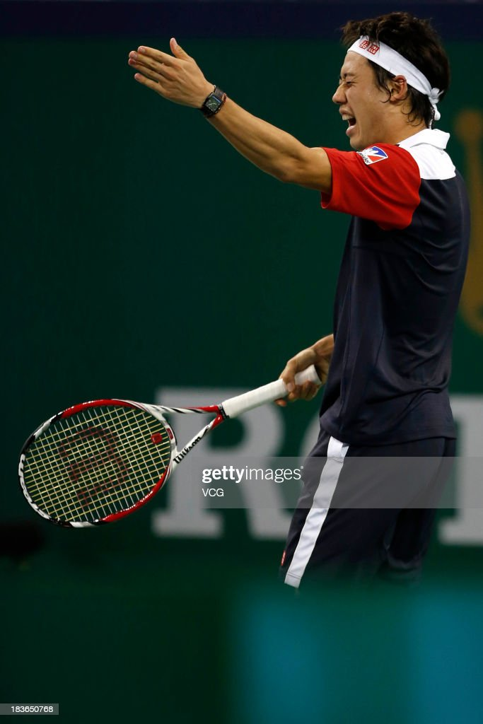 <a gi-track='captionPersonalityLinkClicked' href=/galleries/search?phrase=Kei+Nishikori&family=editorial&specificpeople=4432498 ng-click='$event.stopPropagation()'>Kei Nishikori</a> of Japan reacts against Grigor Dimitrov of Bulgaria on day two of the Shanghai Rolex Masters at the Qi Zhong Tennis Center on October 8, 2013 in Shanghai, China.