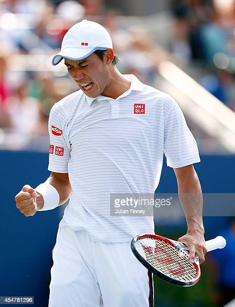 Kei Nishikori of Japan reacts against Novak Djokovic of Serbia during their men's singles semifinal match on Day Thirteen of the 2014 US Open at the...