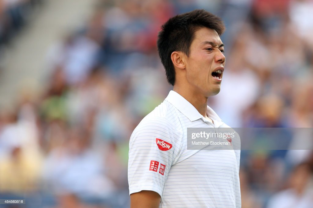<a gi-track='captionPersonalityLinkClicked' href=/galleries/search?phrase=Kei+Nishikori&family=editorial&specificpeople=4432498 ng-click='$event.stopPropagation()'>Kei Nishikori</a> of Japan reacts against Stan Wawrinka of Switzerland during their men's singles quarterfinal match on Day Ten of the 2014 US Open at the USTA Billie Jean King National Tennis Center on September 3, 2014 in the Flushing neighborhood of the Queens borough of New York City.