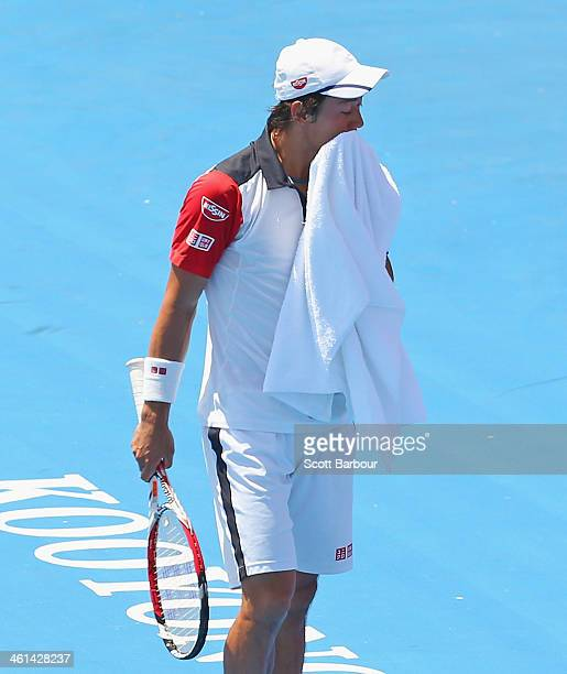 Kei Nishikori of Japan reacts during his match against Tomas Berdych of the Czech Republic during day two of the AAMI Classic at Kooyong on January 9...