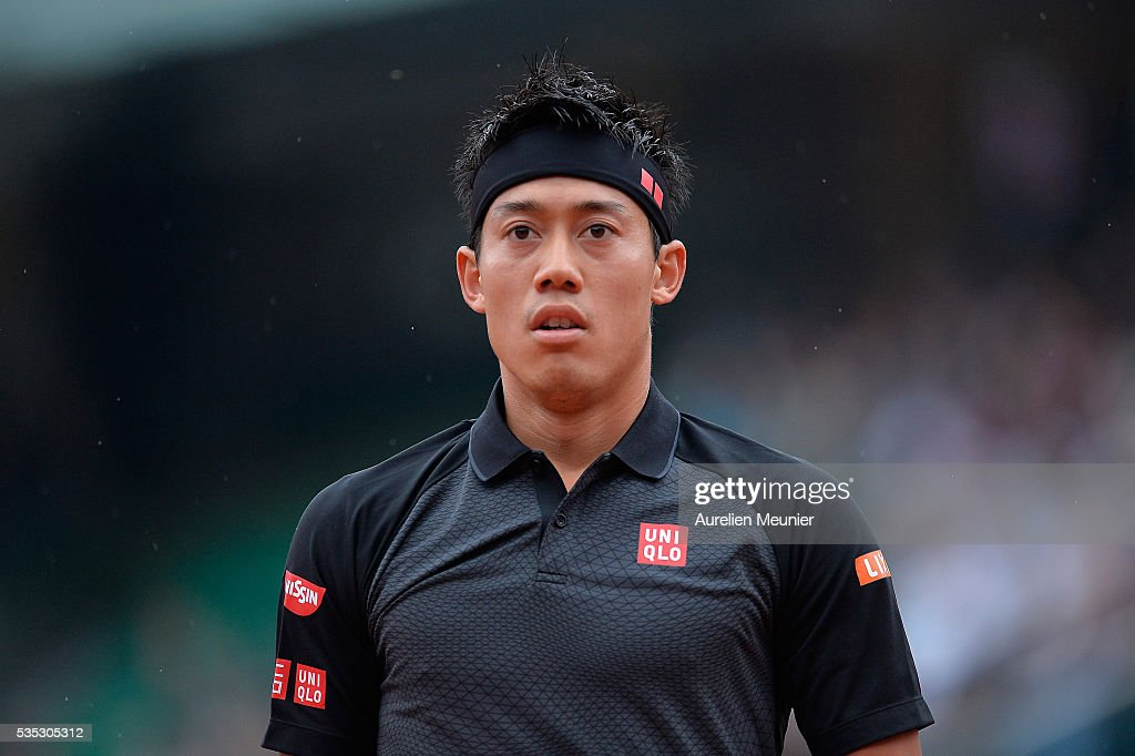 <a gi-track='captionPersonalityLinkClicked' href=/galleries/search?phrase=Kei+Nishikori&family=editorial&specificpeople=4432498 ng-click='$event.stopPropagation()'>Kei Nishikori</a> of Japan reacts during his men's singles fourth round match against Richard Gasquet of France on day eight of the 2016 French Open at Roland Garros on May 29, 2016 in Paris, France.