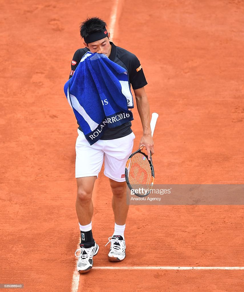 Kei Nishikori of Japan reacts during the match against Richard Gasquet of France, during the men's single fourth round match at the French Open tennis tournament at Roland Garros Stadium in Paris, France on May 29, 2016.