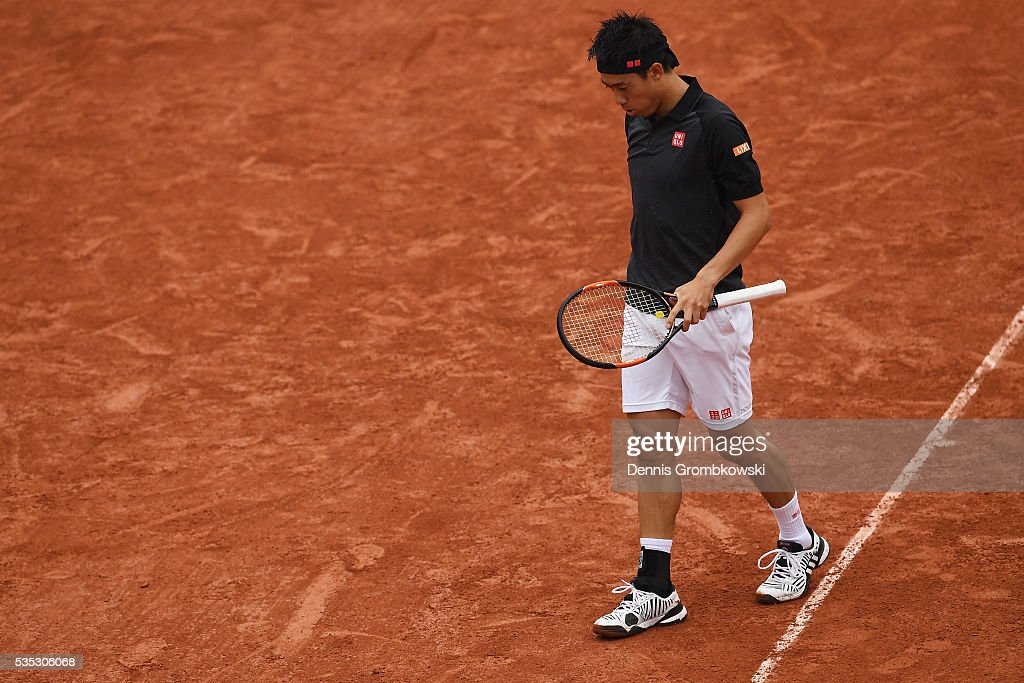 <a gi-track='captionPersonalityLinkClicked' href=/galleries/search?phrase=Kei+Nishikori&family=editorial&specificpeople=4432498 ng-click='$event.stopPropagation()'>Kei Nishikori</a> of Japan reacts during the Mens Singles fourth round match against Richard Gasquet of France on day eight of the 2016 French Open at Roland Garros on May 29, 2016 in Paris, France.