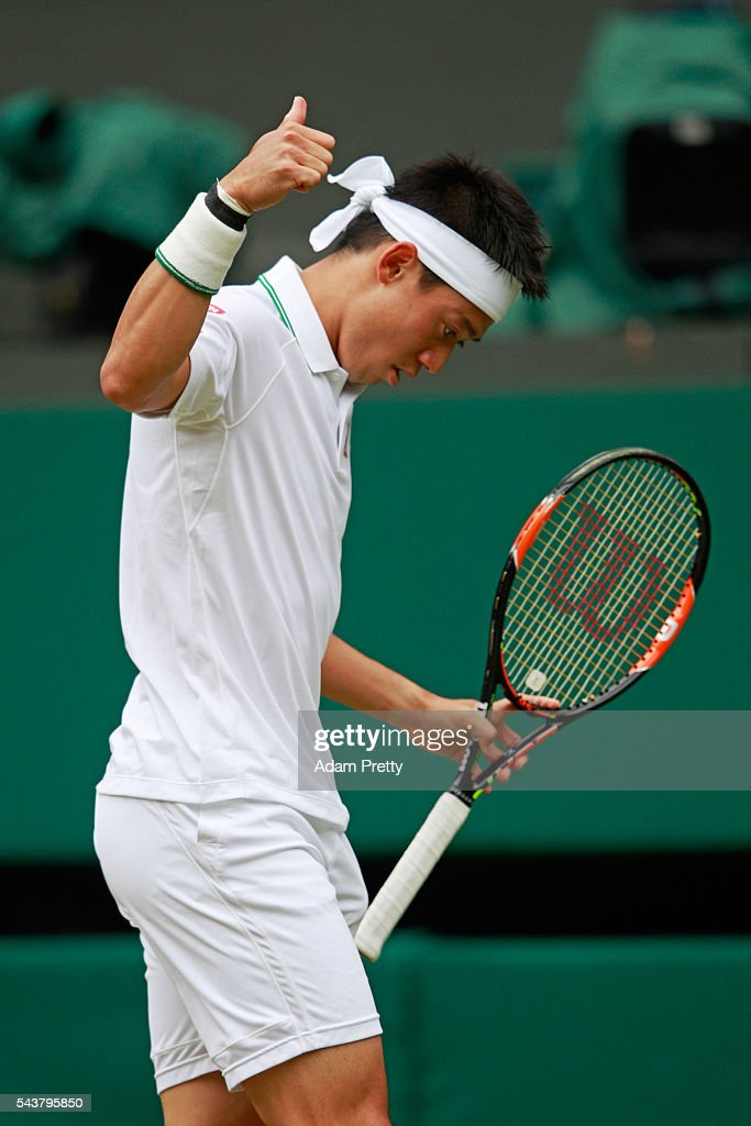 Kei Nishikori of Japan reacts during the Men's Singles second round match against Julien Benneteau of France on day four of the Wimbledon Lawn Tennis Championships at the All England Lawn Tennis and Croquet Club on June 30, 2016 in London, England.