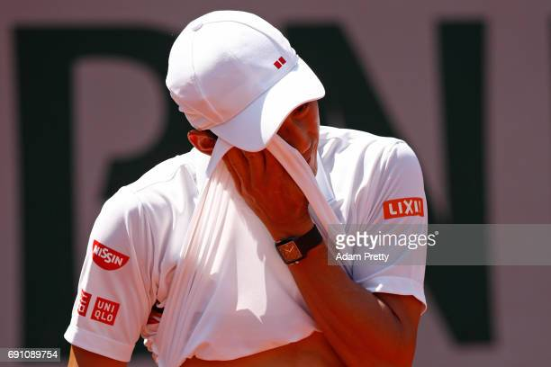 Kei Nishikori of Japan reacts during the men's singles second round match against Jeremy Chardy of France on day five of the 2017 French Open at...