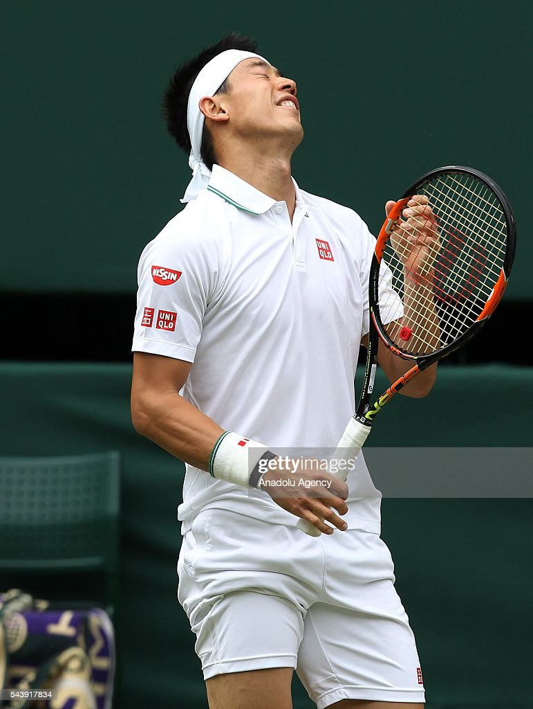 Kei NIshikori of Japan reacts during the tennis match against Julien Benneteau (not seen) of France in the men's singles on day four of the 2016 Wimbledon Championships at the All England Lawn and Croquet Club in London, United Kingdom on June 30, 2016.