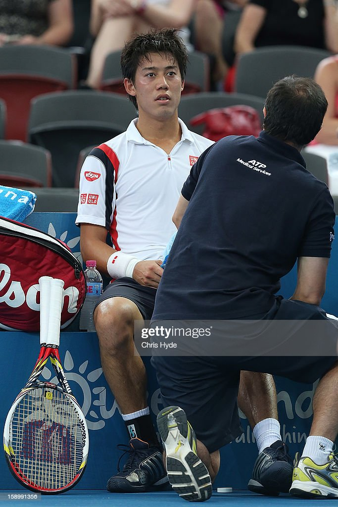 Kei Nishikori of Japan receives medical attention before retiring injured during his semi final match against Andy Murray of Great Britain on day seven of the Brisbane International at Pat Rafter Arena on January 5, 2013 in Brisbane, Australia.