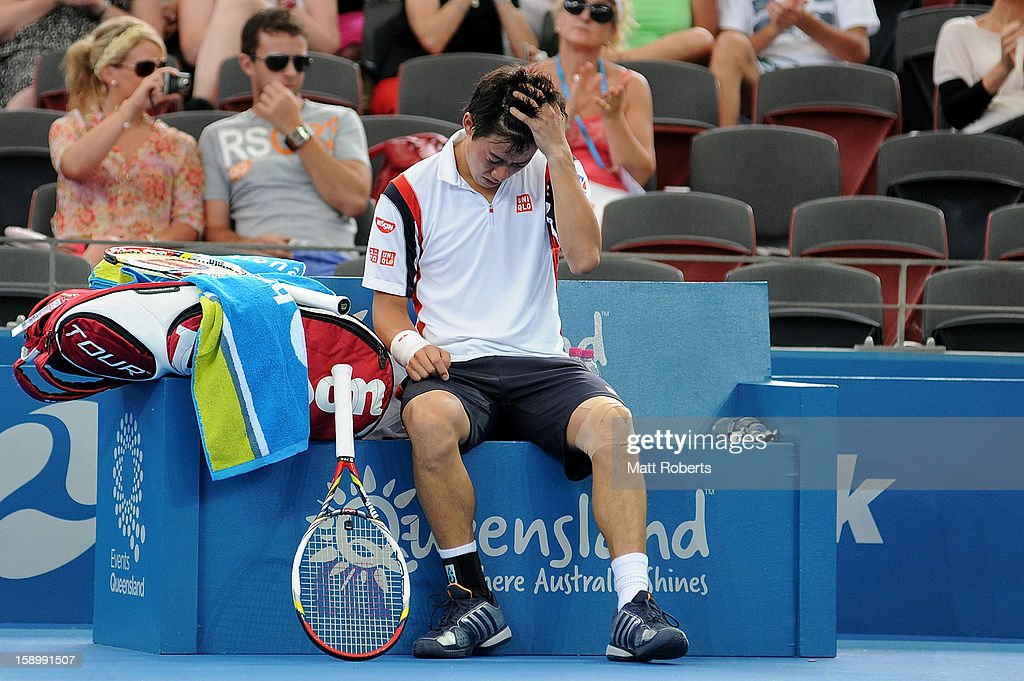 Kei Nishikori of Japan retires injured his semi final match against Andy Murray of Great Britain on day seven of the Brisbane International at Pat Rafter Arena on January 5, 2013 in Brisbane, Australia.