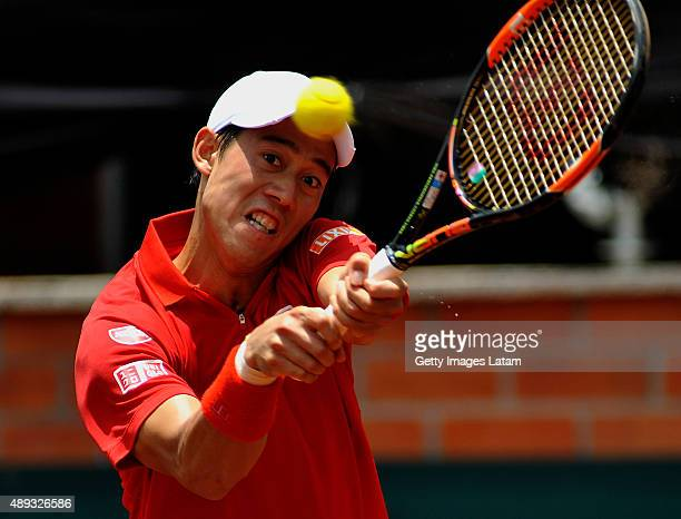 Kei Nishikori of Japan returns a backhand shot during the Davis Cup World Group Playoff singles match between Santiago Giraldo of Colombia and Kei...