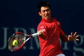 Kei Nishikori of Japan returns a shot against Stan Wawrinka of Switzerland during their men's singles quarterfinal match on Day Ten of the 2014 US...