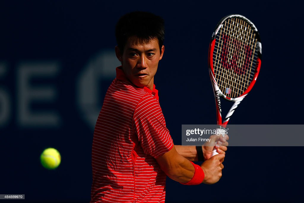 Kei Nishikori of Japan returns a shot against Stan Wawrinka of Switzerland during their men's singles quarterfinal match on Day Ten of the 2014 US Open at the USTA Billie Jean King National Tennis Center on September 3, 2014 in the Flushing neighborhood of the Queens borough of New York City.