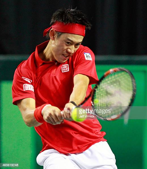 Kei Nishikori of Japan returns a shot during his Davis Cup match against Milos Raonic of Canada March 8 2015 in Vancouver British Columbia Canada...