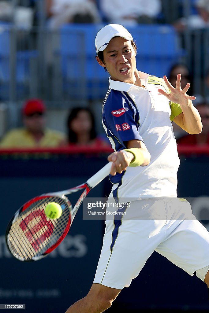Kei Nishikori of Japan returns a shot to Andreas Seppi of Italy during the Rogers Cup at Uniprix Stadium on August 6, 2013 in Montreal, Quebec, Canada.