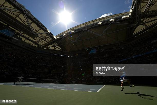 Kei Nishikori of Japan returns a shot to Andy Murray of Great Britain during their Men's Singles Quarterfinal match on Day Ten of the 2016 US Open at...