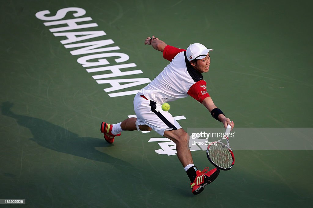 <a gi-track='captionPersonalityLinkClicked' href=/galleries/search?phrase=Kei+Nishikori&family=editorial&specificpeople=4432498 ng-click='$event.stopPropagation()'>Kei Nishikori</a> of Japan returns a shot to Jo-Wilfried Tsonga of France during day four of the Shanghai Rolex Masters at the Qi Zhong Tennis Center on October 10, 2013 in Shanghai, China.