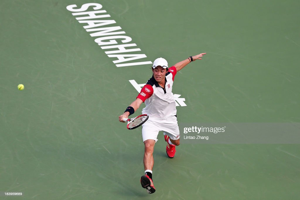<a gi-track='captionPersonalityLinkClicked' href=/galleries/search?phrase=Kei+Nishikori&family=editorial&specificpeople=4432498 ng-click='$event.stopPropagation()'>Kei Nishikori</a> of Japan returns a shot to Jo-Wilfried Tsonga of France during day four of the Shanghai Rolex Masters at the Qi Zhong Tennis Center on October 9, 2013 in Shanghai, China.