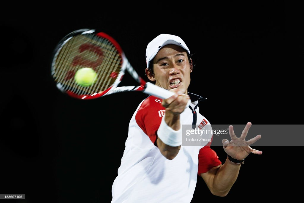 Kei Nishikori of Japan returns a shot to Jurgen Melzer of Austria during day three of the Shanghai Rolex Masters at the Qi Zhong Tennis Center on October 9, 2013 in Shanghai, China.