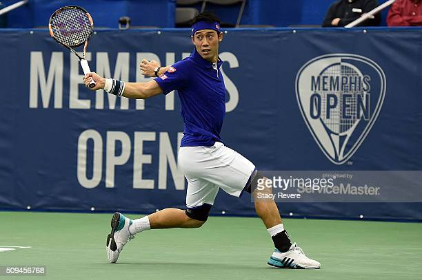 Kei Nishikori of Japan returns a shot to Ryan Harrison of the United States during their singles match on Day 3 of the Memphis Openat the Racquet...