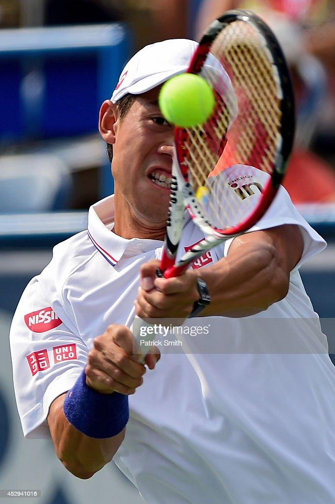 Kei Nishikori of Japan returns a shot to Sam Querrey of the United States during Day 3 of the Citi Open at the William H.G. FitzGerald Tennis Center on July 30, 2014 in Washington, DC.