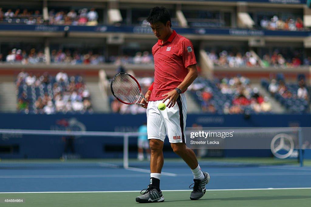 Kei Nishikori of Japan returns looks on against Stan Wawrinka of Switzerland during their men's singles quarterfinal match on Day Ten of the 2014 US Open at the USTA Billie Jean King National Tennis Center on September 3, 2014 in the Flushing neighborhood of the Queens borough of New York City.