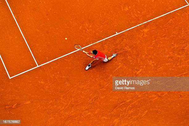 Kei Nishikori of Japan returns the ball against Albert Ramos of Spain during day five of the 2013 Barcelona Open Banc Sabadell on April 26 2013 in...