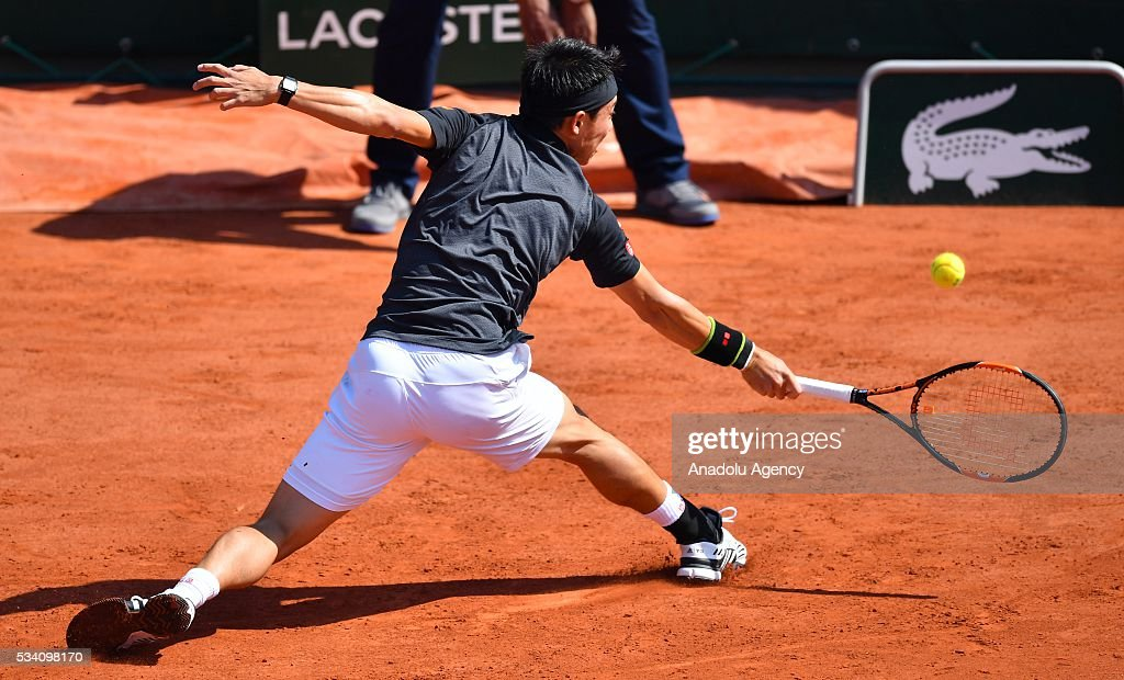 Kei Nishikori of Japan returns the ball to Andrey Kuznetsov (not seen) of Russia during their men's single 2nd round match at the French Open tennis tournament at Roland Garros in Paris, France on May 25, 2016.