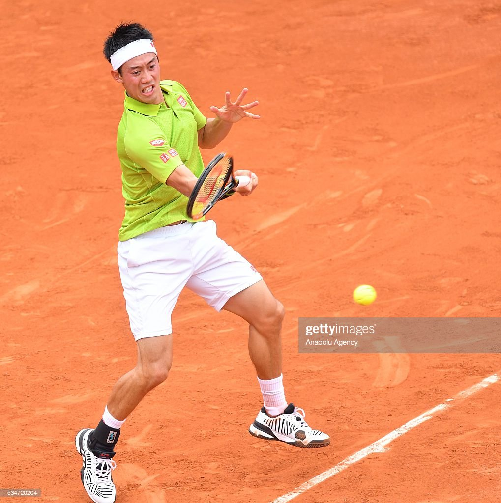 Kei Nishikori of Japan returns to Fernando Verdasco of Spain (not seen) during the men's single third round match at the French Open tennis tournament at Roland Garros Stadium in Paris, France on May 27, 2016.