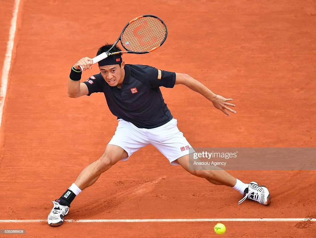 Kei Nishikori of Japan returns to Richard Gasquet of France during the men's single fourth round match at the French Open tennis tournament at Roland Garros Stadium in Paris, France on May 29, 2016.