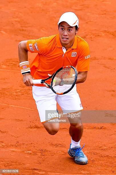 Kei Nishikori of Japan runs against Jeremy Chardy of France during day four of the Barcelona Open Banc Sabadell at the Real Club de Tenis Barcelona...
