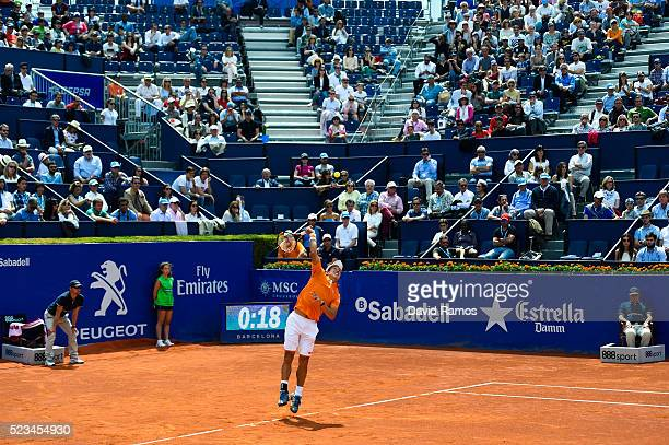 Kei Nishikori of Japan serves against Benoit Paire of France during day six of the Barcelona Open Banc Sabadell at the Real Club de Tenis Barcelona...