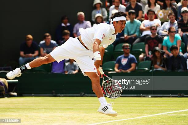 Kei Nishikori of Japan serves during his Gentlemen's Singles fourth round match against Milos Raonic of Canada on day eight of the Wimbledon Lawn...