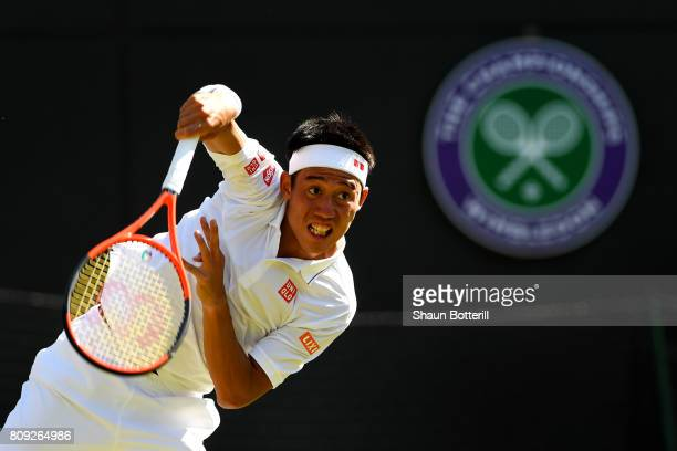 Kei Nishikori of Japan serves during the Gentlemen's Singles second round match against Sergiy Stakhovsky of Ukraine on day three of the Wimbledon...
