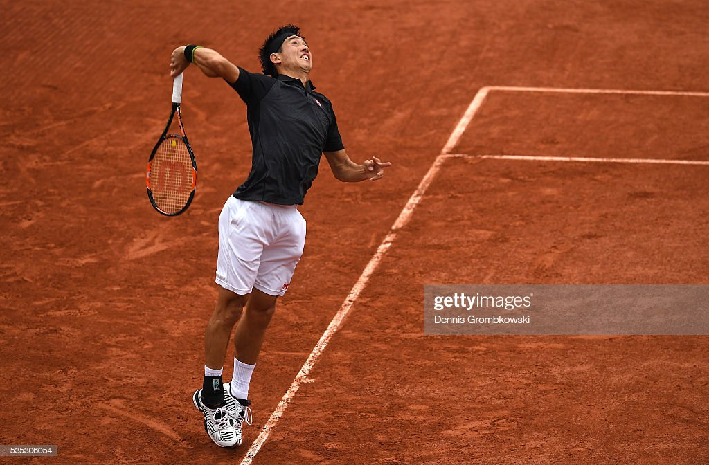 <a gi-track='captionPersonalityLinkClicked' href=/galleries/search?phrase=Kei+Nishikori&family=editorial&specificpeople=4432498 ng-click='$event.stopPropagation()'>Kei Nishikori</a> of Japan serves during the Mens Singles fourth round match against Richard Gasquet of France on day eight of the 2016 French Open at Roland Garros on May 29, 2016 in Paris, France.
