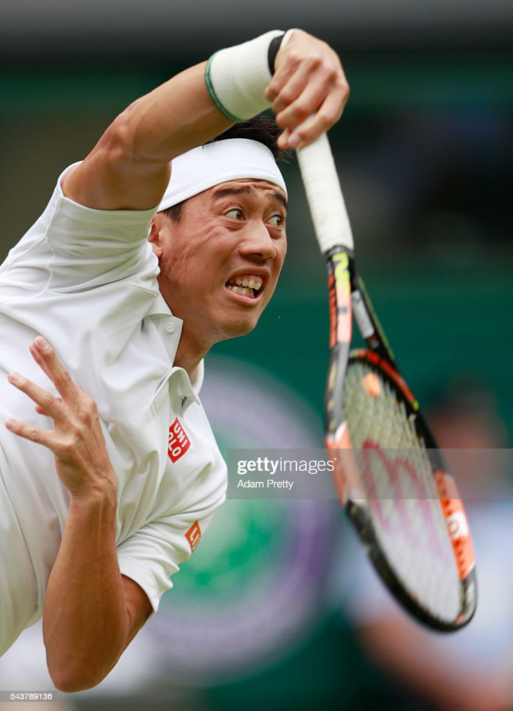 Kei Nishikori of Japan serves during the Men's Singles second round match against Julien Benneteau of France on day four of the Wimbledon Lawn Tennis Championships at the All England Lawn Tennis and Croquet Club on June 30, 2016 in London, England.