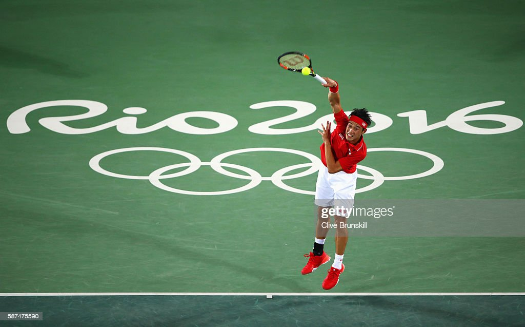 Kei Nishikori of Japan serves during the Men's Singles second round match against John Millman of Australia on Day 3 of the Rio 2016 Olympic Games at the Olympic Tennis Centre on August 8, 2016 in Rio de Janeiro, Brazil.