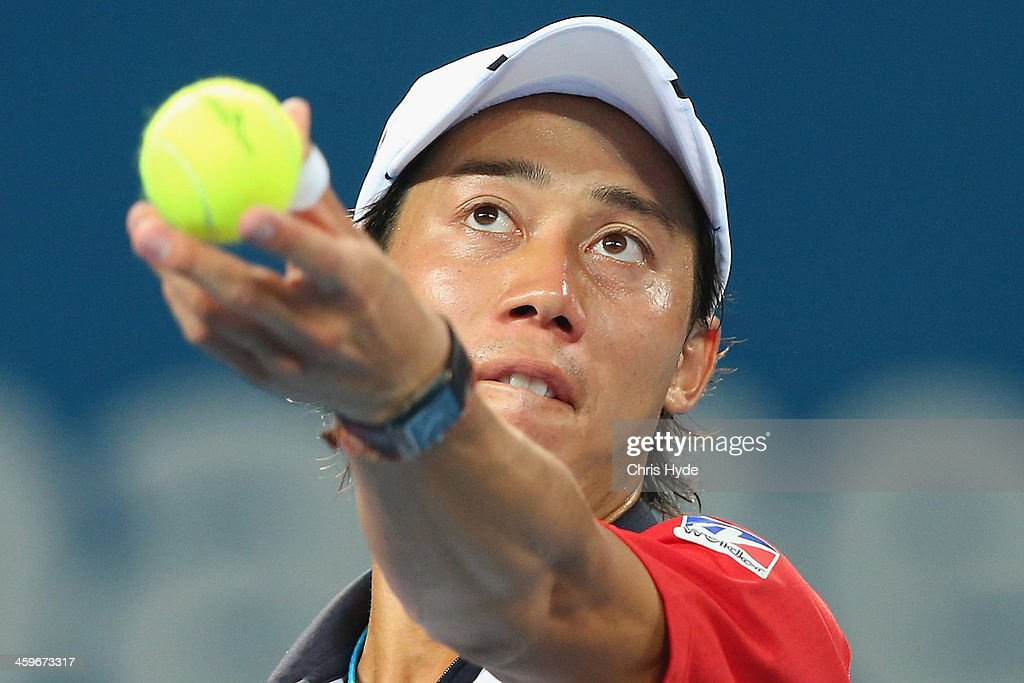 <a gi-track='captionPersonalityLinkClicked' href=/galleries/search?phrase=Kei+Nishikori&family=editorial&specificpeople=4432498 ng-click='$event.stopPropagation()'>Kei Nishikori</a> of Japan serves in his doubles match with doubles partner Sam Querrey of the USA against Marinko Matosevic of Australia and Dmitry Tursunov of Russia during day one of the 2014 Brisbane International at Queensland Tennis Centre on December 29, 2013 in Brisbane, Australia.