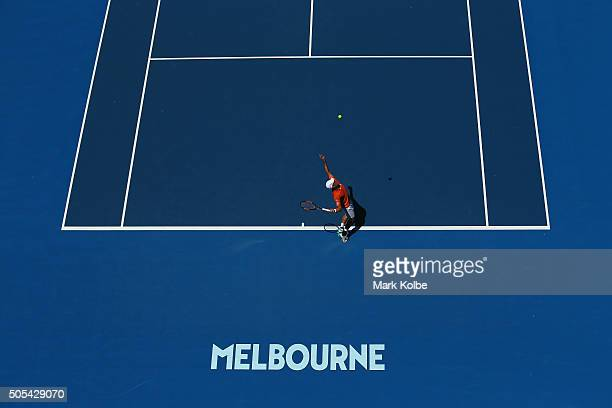 Kei Nishikori of Japan serves in his first round match against Phillip Kohlschreiber of Gemany during day one of the 2016 Australian Open at...