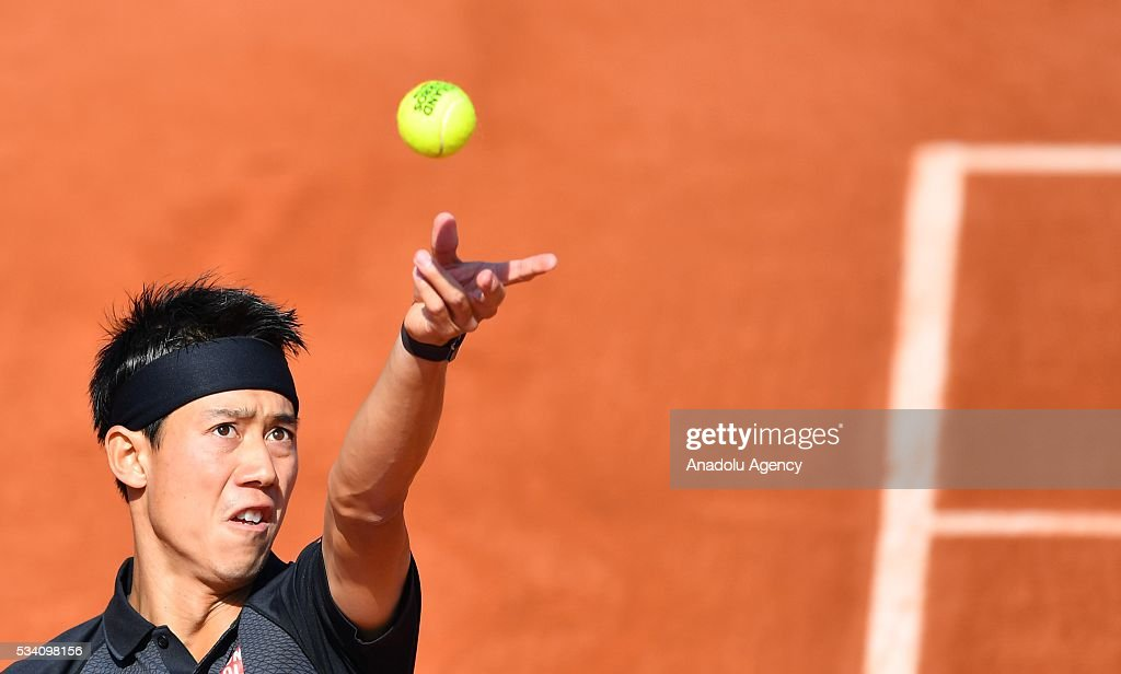 Kei Nishikori of Japan serves to Andrey Kuznetsov (not seen) of Russia during their men's single 2nd round match at the French Open tennis tournament at Roland Garros in Paris, France on May 25, 2016.