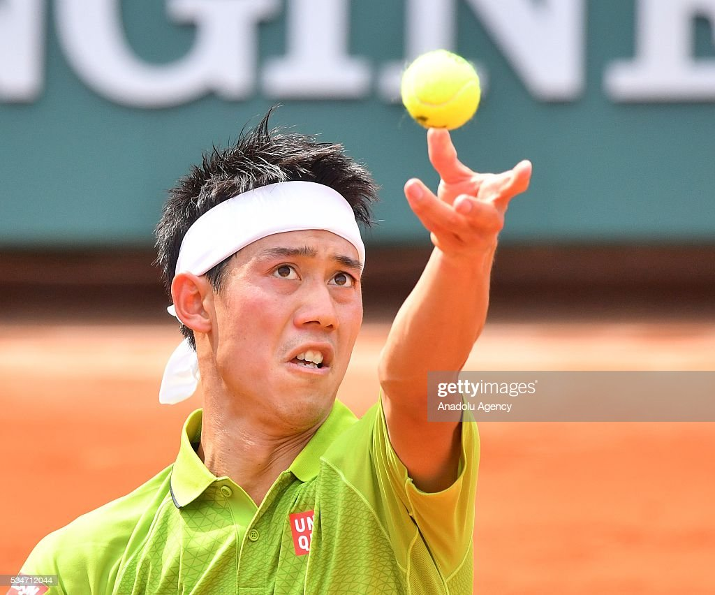 Kei Nishikori of Japan serves to Fernando Verdasco of Spain (not seen) during the men's single third round match at the French Open tennis tournament at Roland Garros Stadium in Paris, France on May 27, 2016.