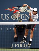 Kei Nishikori of Japan serves to Marin Cilic of Croatia during their US Open 2014 men's singles finals match at the USTA Billie Jean King National...