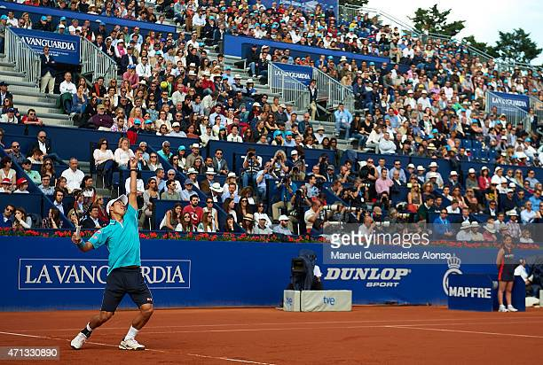 Kei Nishikori of Japan serves to Pablo Andujar of Spain in the final during day seven of the Barcelona Open Banc Sabadell at the Real Club de Tenis...