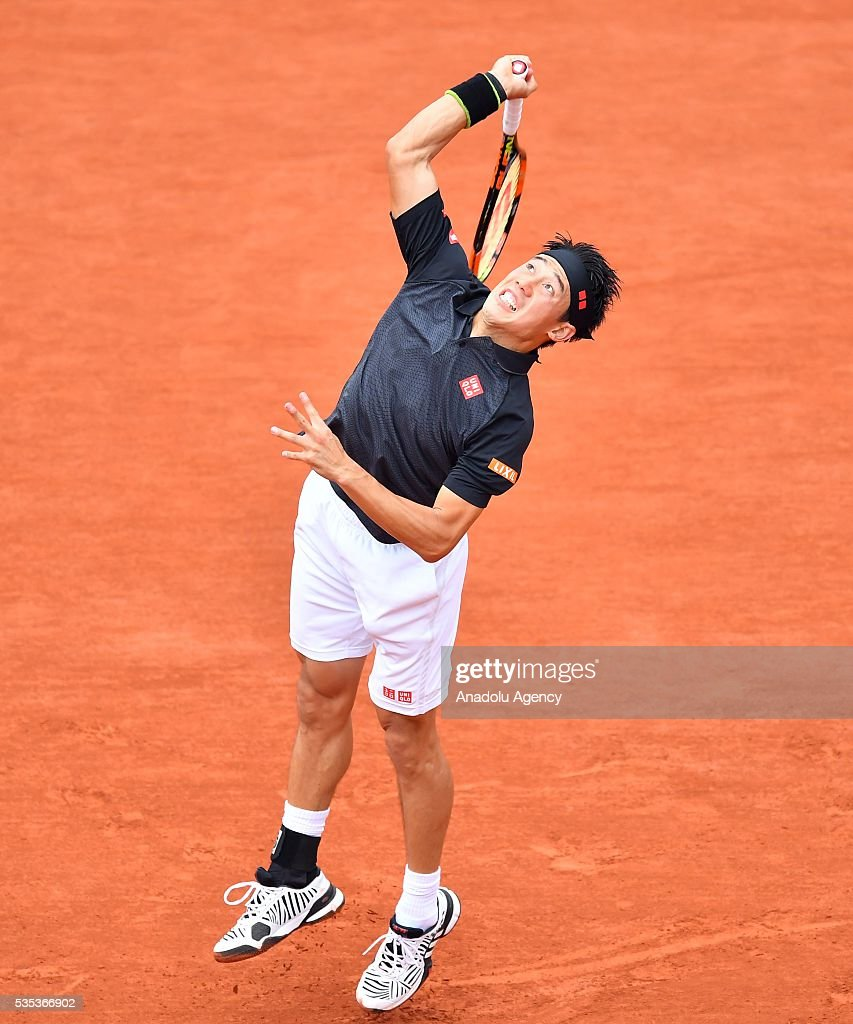 Kei Nishikori of Japan serves to Richard Gasquet of France during the men's single fourth round match at the French Open tennis tournament at Roland Garros Stadium in Paris, France on May 29, 2016.
