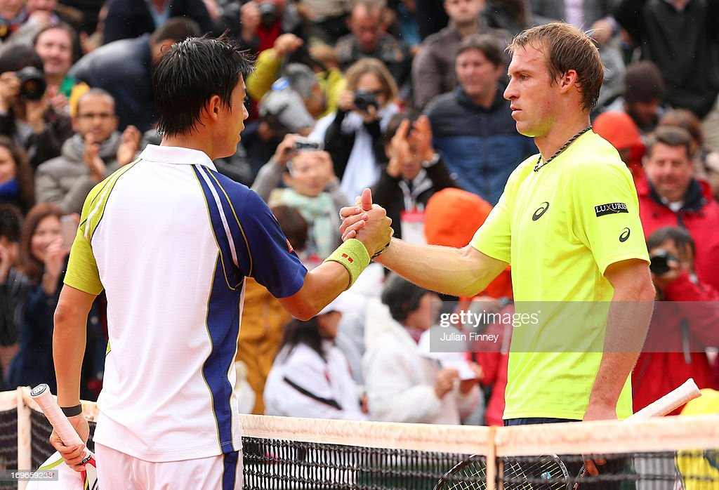 <a gi-track='captionPersonalityLinkClicked' href=/galleries/search?phrase=Kei+Nishikori&family=editorial&specificpeople=4432498 ng-click='$event.stopPropagation()'>Kei Nishikori</a> of Japan shakes hand sat the net with his opponent <a gi-track='captionPersonalityLinkClicked' href=/galleries/search?phrase=Grega+Zemlja&family=editorial&specificpeople=3098293 ng-click='$event.stopPropagation()'>Grega Zemlja</a> of Slovenia after victory in their Men's Singles match during day five of the French Open at Roland Garros on May 30, 2013 in Paris, France.