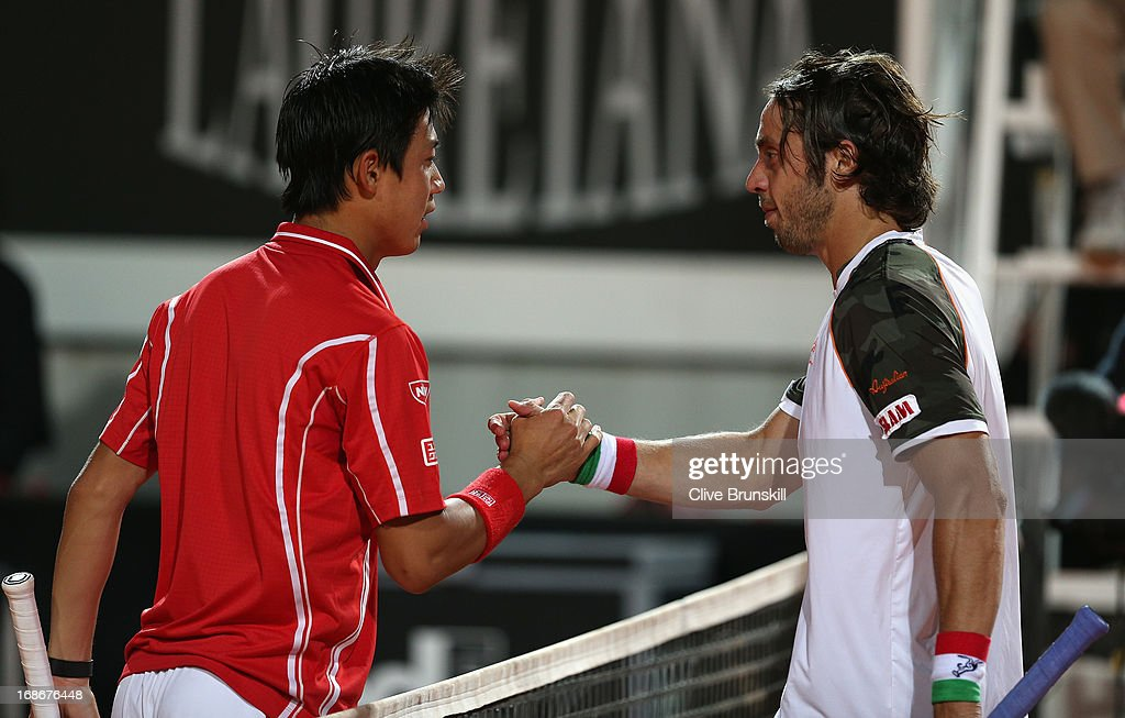 Kei Nishikori of Japan shakes hands at the net after his straight sets victory against Paolo Lorenzi of Italy in their first round match during day two of the Internazionali BNL d'Italia 2013 at the Foro Italico Tennis Centre on May 13, 2013 in Rome, Italy.