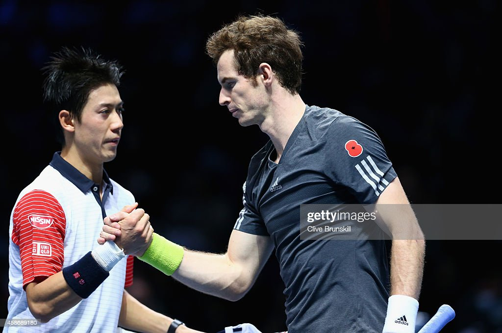 Kei Nishikori of Japan shakes hands at the net after his straight sets victory against Andy Murray during their round robin match during the Barclays ATP World Tour Finals at the O2 Arena on November 9, 2014 in London, England.